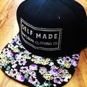 Image of Raw Caviar Limited Edition Black and Purple Snapback Floral
