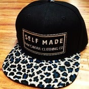 Image of Teal Cheetah with Teal Snap Raw Caviar Self Made Snapback