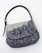 Image of a large tough ruffles shoulder bag in two shades of grey