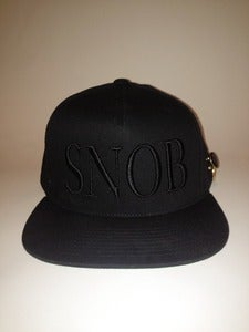 Image of SNOB SNAPBACK BLACKED OUT