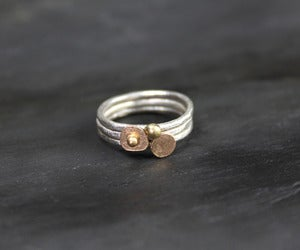 Image of Silver and gold stacking ring set