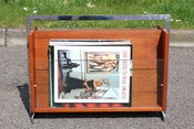 Image of British Merrow Associates style teak and chromed steel magazine rack circa 1960/70s