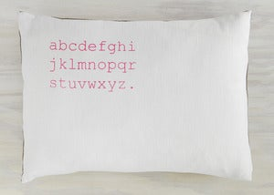 Image of alphabet pillow white with neon pink text