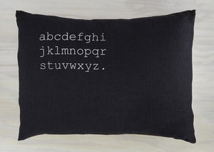 Image of alphabet pillow graphite