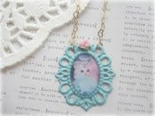 Image of White Kitten in Blue Frame with Pink Flower Necklace