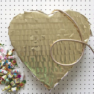 Image of Xanthe Highfield's gold heart piñata