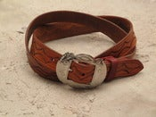 Image of mens belt with vintage indian buckle
