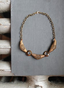 Image of unearthed tribal cage necklace