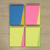 Image of neon triangle notebooks
