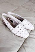 Image of white woven sandals