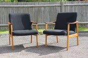 Image of Pair of vintage Danish style teak and beech wood armchairs circa 1960's