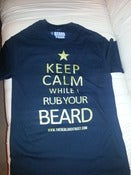 Image of LADIES KEEP CALM WHILE I RUB YOUR BEARD TSHIRT BLACK WITH GOLD PRINT