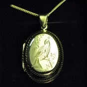 Image of Hand Engraved Silver Sitting Bird Locket