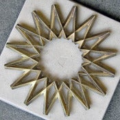Image of galaxy brass trivet