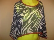 Image of sheer zebra top