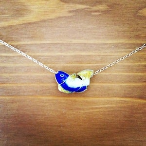 Image of blue fish necklace