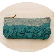 Image of roundy-bottomed tough ruffles zipper purse in vintage lace + teal