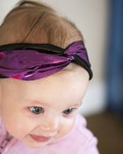 Image of tiny metallic purple and black turban