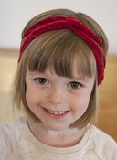 Image of red crushed velvet mini turban