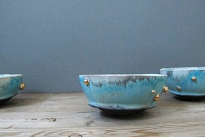 Image of turquoise blue monk bowl with gold inclusions