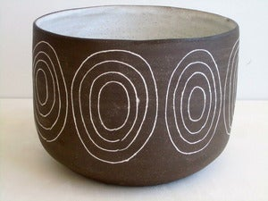 Image of dark brown stoneware circle bowl