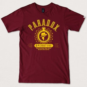 "Image of ""P.A.R.A.D.O.X. Operative"" - Burgundy tee yellow print"
