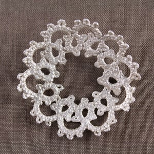 Image of doily brooch
