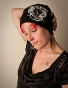 Image of Unisex Black Beanie cap with Flashlight Logo in White