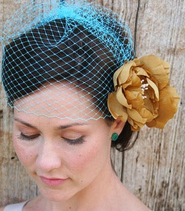 Image of Josephine II - Simple Birdcage Veil in Turquoise paired with double golden yellow silk flower