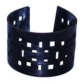 Image of Square Dot Bracelets cut out of recycled BLACK and RED vinyl records.