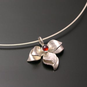 Image of Sterling Lotus Pendant with Garnet Center