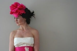 Image of Pink Lia silk flower headpiece paired with black birdcage veil