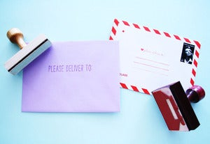 "Image of ""Please deliver to"" wooden stamp"
