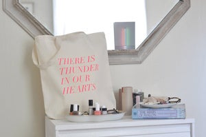 Image of thunder in our hearts tote in fluro pink