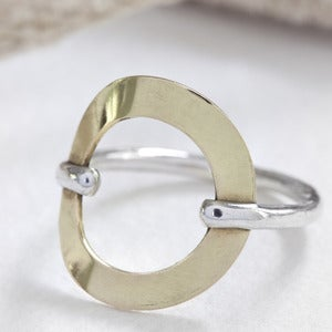 Image of sterling silver and 18k gold karma ring