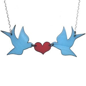 Image of Ltd. Edition Kissing Swallows Necklace made from recycled vinyl records.