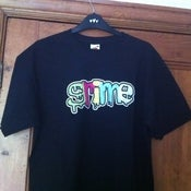 Image of Colour Grime Logo on different colour T Shirts - Men and Women's
