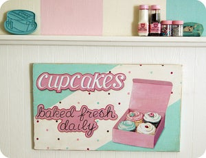 Image of cupcakes baked fresh daily wood sign