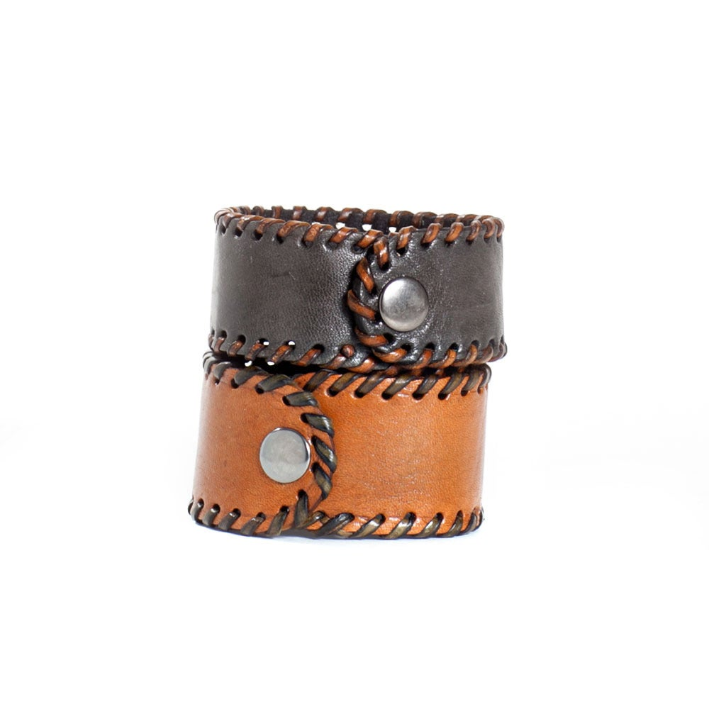 Image of Snap cuffs with leather trim