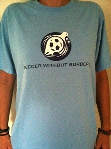 Image of Soccer Without Borders Light Blue T-Shirt