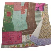 Image of Multi Colored Quilt with Kettle