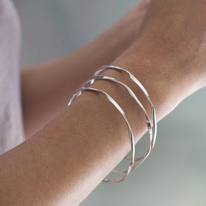 Image of sterling silver ribbon bangles