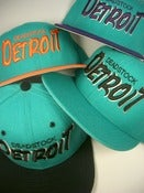 Image of VINTAGE NEW ERA DETROIT DEADSTOCK SNAPBACK (MANY COLORS)