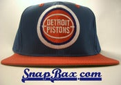 Image of VINTAGE DETROIT PISTONS TWILL TWINS BAD BOYS BLUE RED SNAPBACK