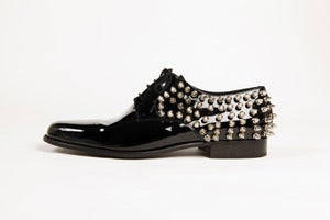 Image of shiny spike shoes