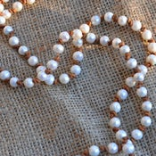 Image of Pearl Necklace On Leather