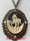 Image of Black Cream Unicorn Necklace on antique gold chain
