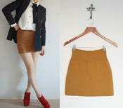 Image of fitting mustard mini skirt S