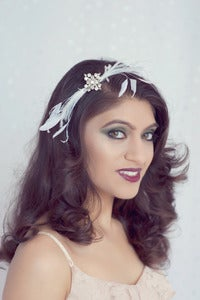 Image of Vintage rhinestone brooch and feather headband
