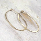 Image of gold oval hoop